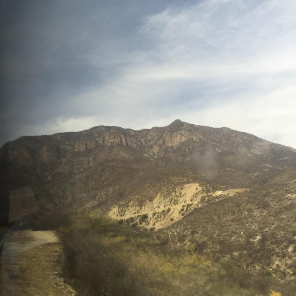 Sierra Gordas from our bus window - arid, rocky landscape