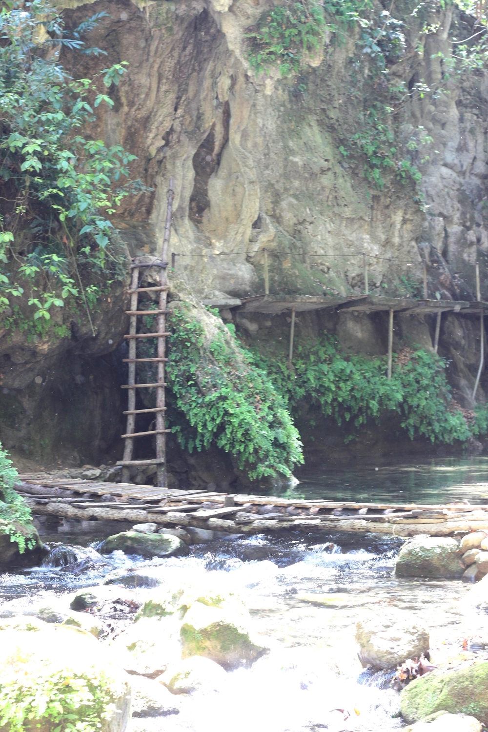 Ladder to foot bridge to more ladders across rivers on the way to Puente de Dios