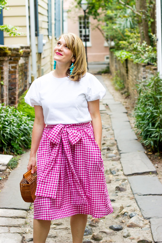 Atlanta blogger Elise Giannasi wears pink gingham skirt with bow from Zara