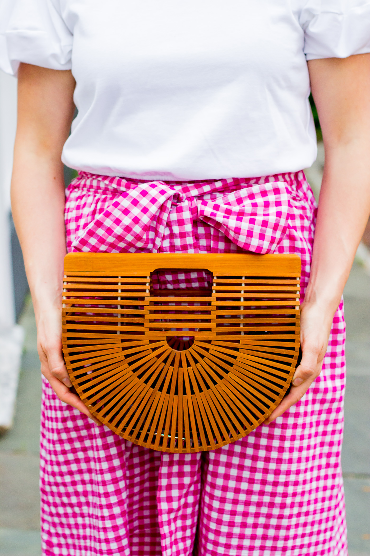 Atlanta blogger Elise Giannasi carries Cult Gaia ark bag