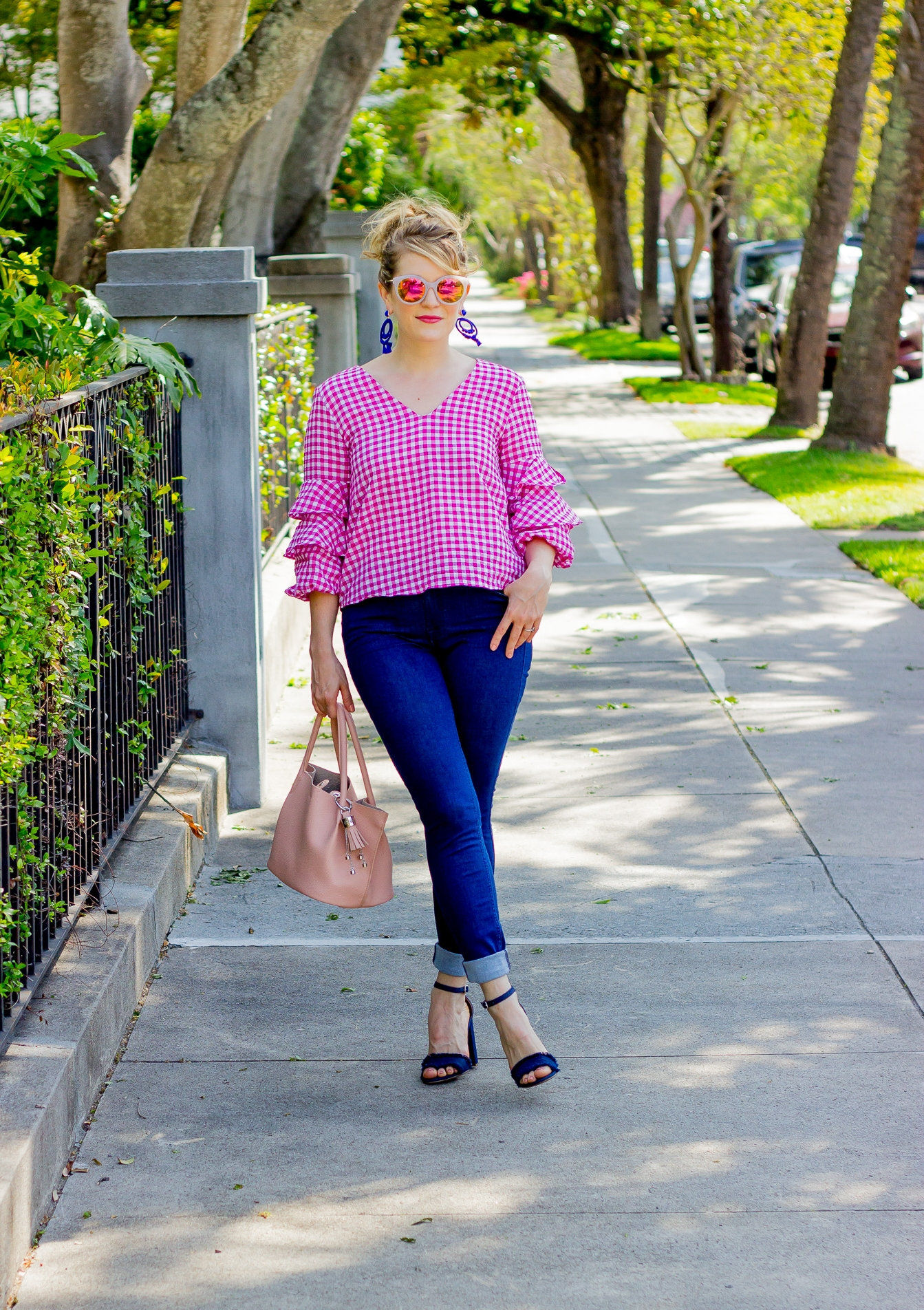 Pink Ruffle Top with skinny jeans on Belle Meets World blog