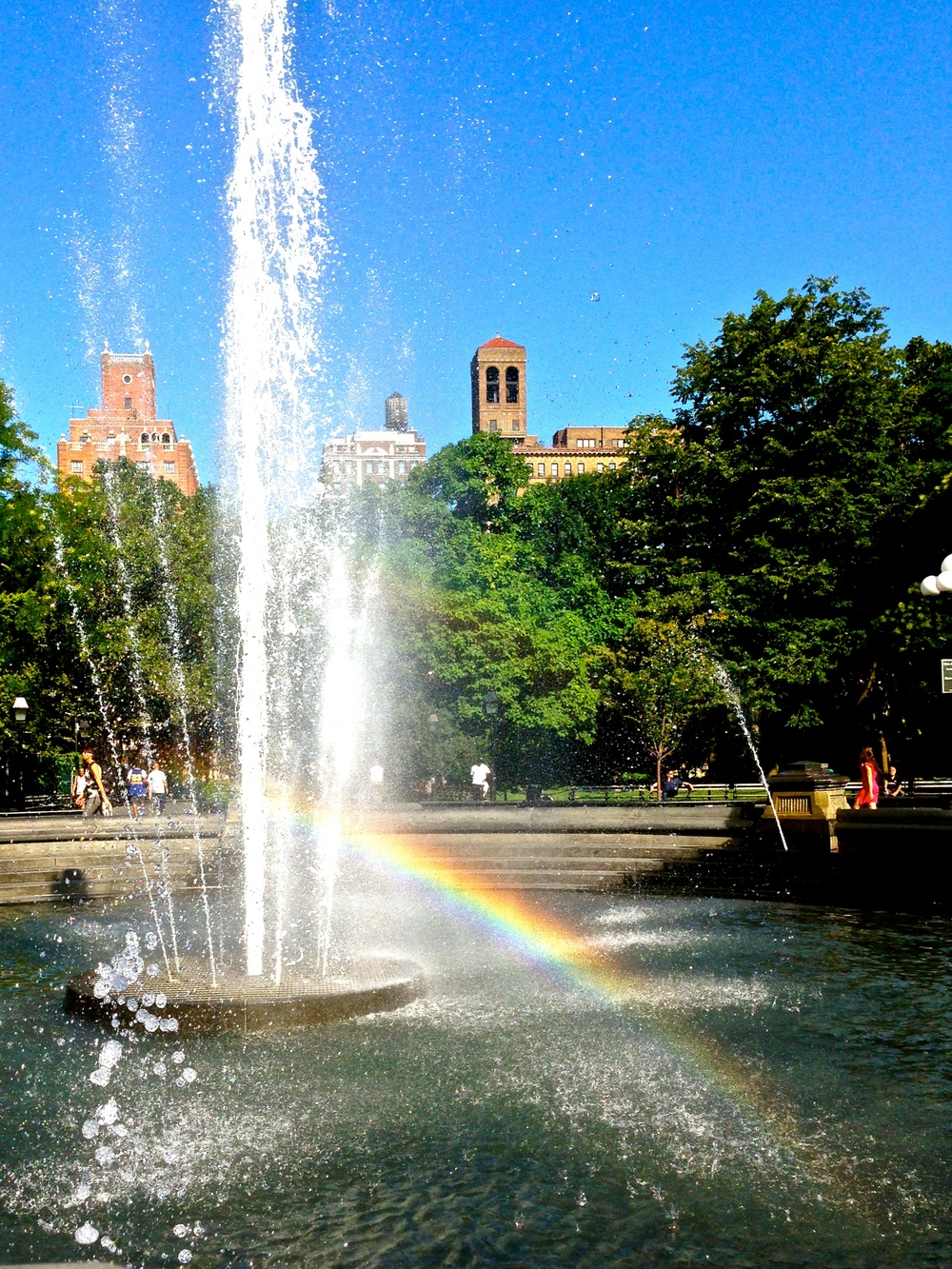 Rainbow in the WSQ Park Fountain I caught just about exactly a year ago.