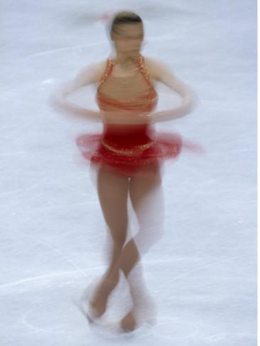 female-figure-skater-preforming-a-spin.jpg