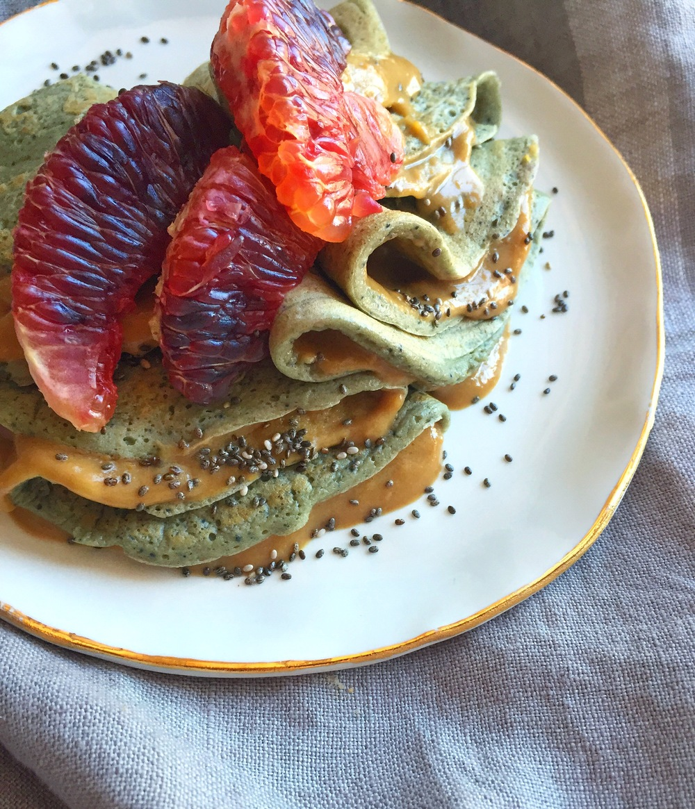 Matcha Oat Crepes  with Meyer Lemon-Caramel Curd, topped w/Blood Orange & Chia Seeds