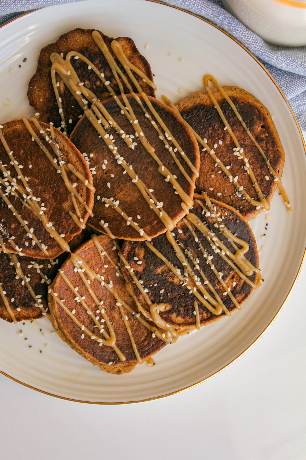 Apple Cinnamon Tahini Oat Pancakes | Living Minnaly __12.jpg