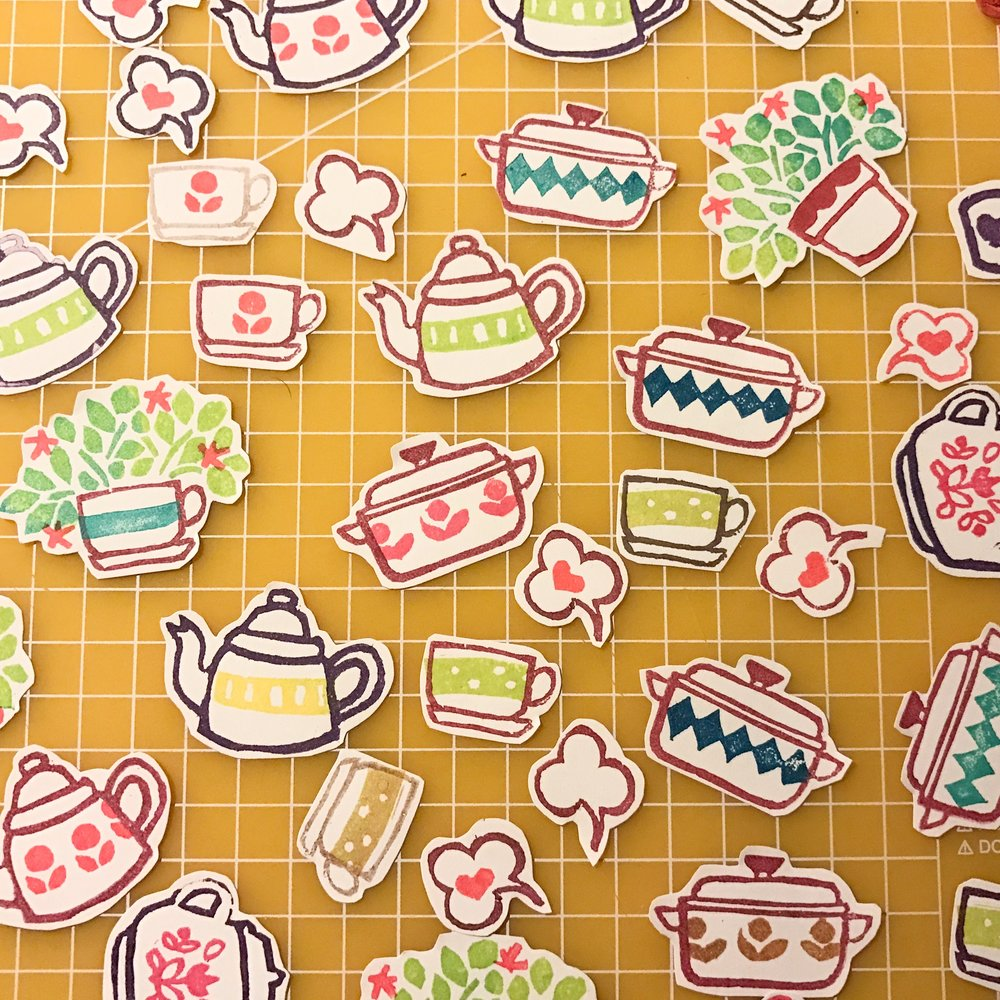 These are cut outs from a large letter sized sheet  of sticker paper, the kind for tags and labels.