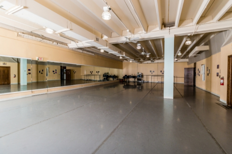 Studio 1 60' x 40' dance space with professional grade sprung wood floors, Marley dance floor covering, full-length mirrors running the length of the studio, a baby grand piano, and full sound system.