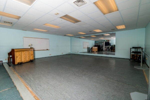Studios 4 24' x 27' dance space with professional grade sprung wood floors, Marley dance floor covering, full-length glassless safety mirrors, an upright piano, and full sound system.