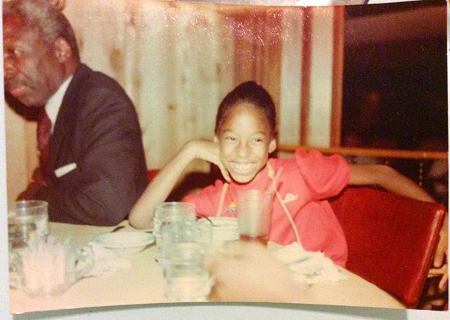Here I'm about 8? I was an only child until I was 10. As such, I was a master inscape artist. If I was bothered by anyone or any situation, I would check out and check inward. I would sing. Lock everyone out. Maintain my inner joy. I was such a happy kid. Now a happy woman. Impenetrable by anyone else's misery or dysfunction. This face is the marker of me. Happy and free. Always. That's my Grandfather. I was raised by this elegant, eloquent, peaceful, and genteel southern gentleman (also earthy Capricorn) who was suited and cologned daily, and made sure I wanted for nothing while my father was overseas for my entire childhood. He is my ruler of a man's measure. This picture brought up so many thoughts about my upbringing and my personality, values and coping mechanisms. Indeed I was raised happy. And that's why I am the person you see today. I think that's my Grandmother's hand. (Leo) Yup, she ruled. Never beat any of her children but we were kept in order and followed orders!😳She was firm but so loving. My mom and I were fortunate to have them in our lives. Fashion sidebar I'm wearing a Jordache drop-waist, flared mini dress with monogram rainbow pin and a handmade African leather purse sent from my Dad around my neck. #childhood #higherloveis #happiness #love #flashback #kid #me #family #joy #present #smile #jordache