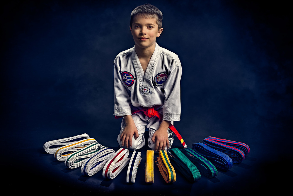 Taekwondo boy and his belts.