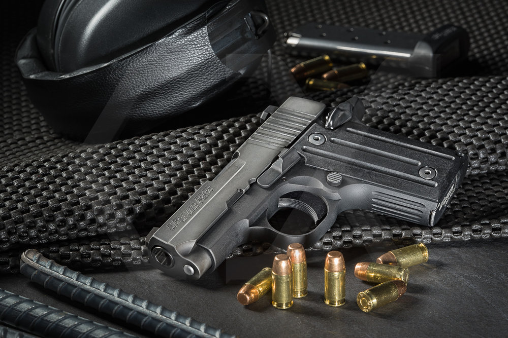 Sig Sauer P238 with ammo, hearing protection, and extra clip