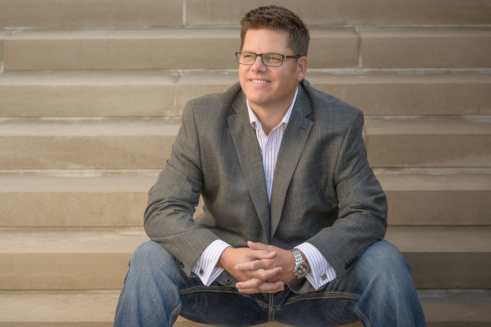 Portrait of Kevin Lewis of Lewis Wealth Management on the steps at The Palladium at the Center for the Performing Arts in Carmel, IN