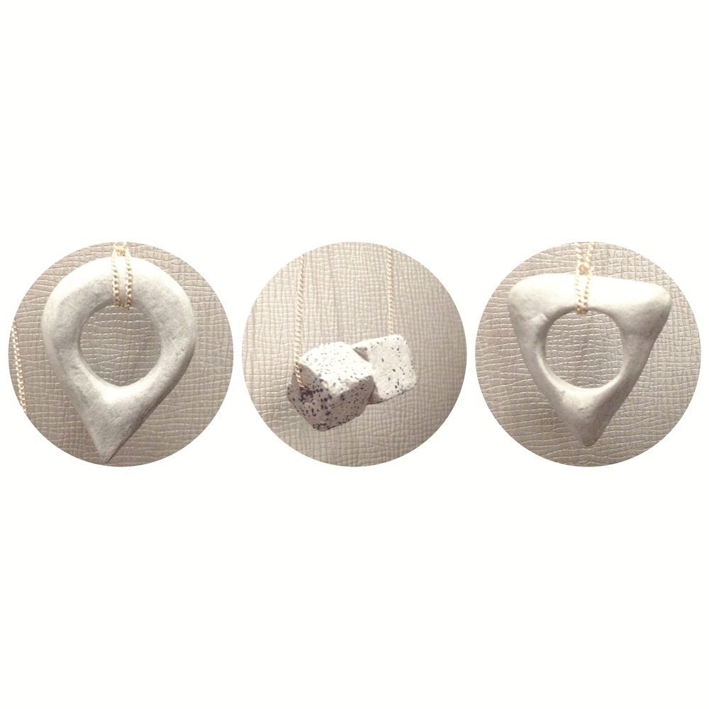 Our newest concrete pendants. From left: You Are Here, Cubic Kiss, & Ouija necklaces.