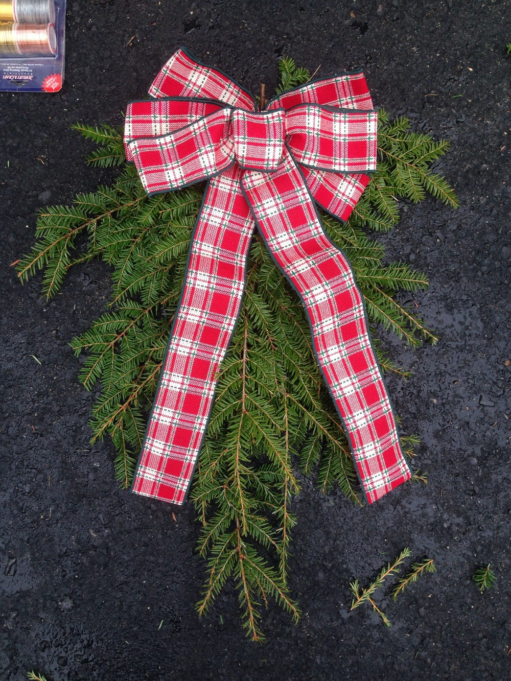 Add a ribbon to the DIY Christmas swag