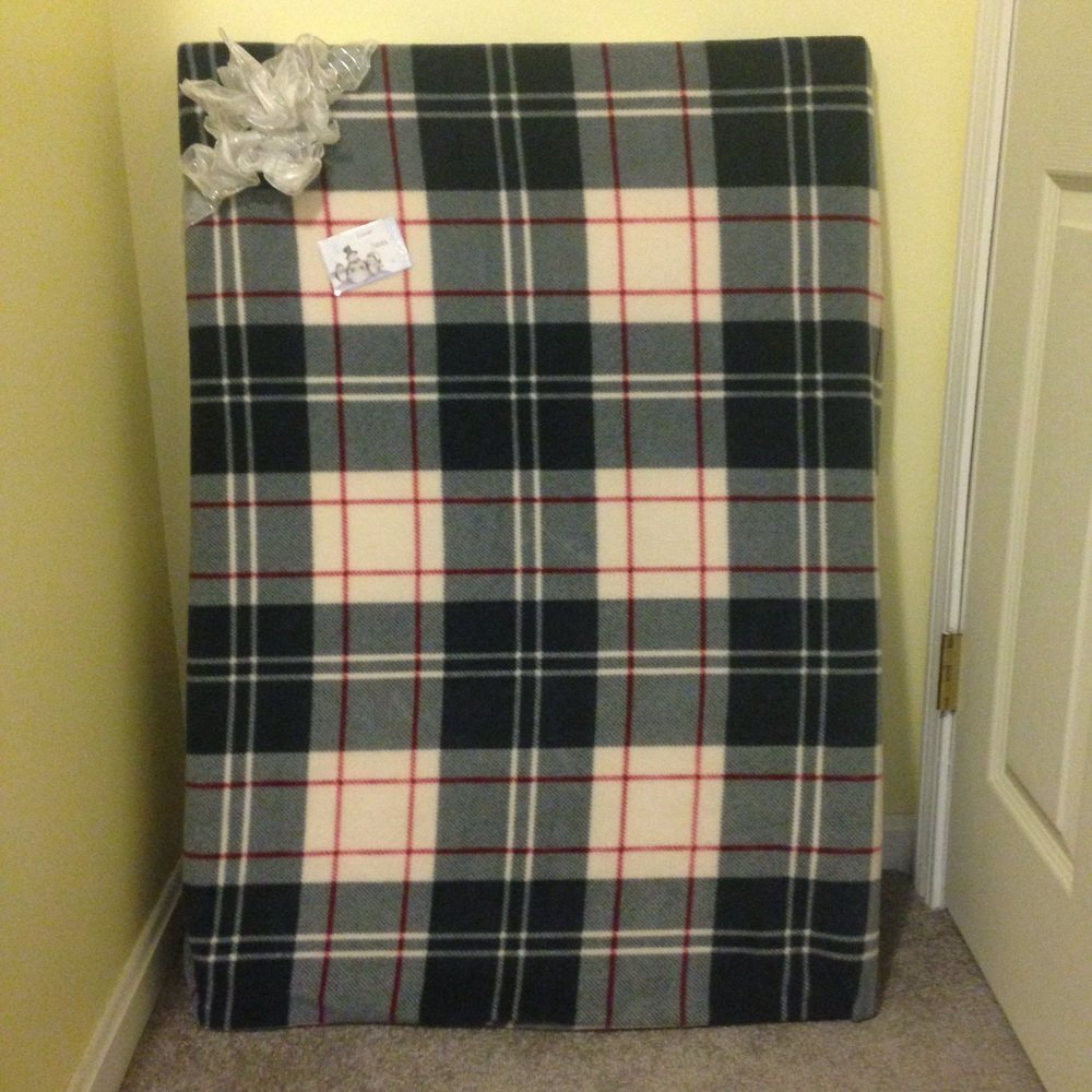Wrap large gifts with a throw blanket