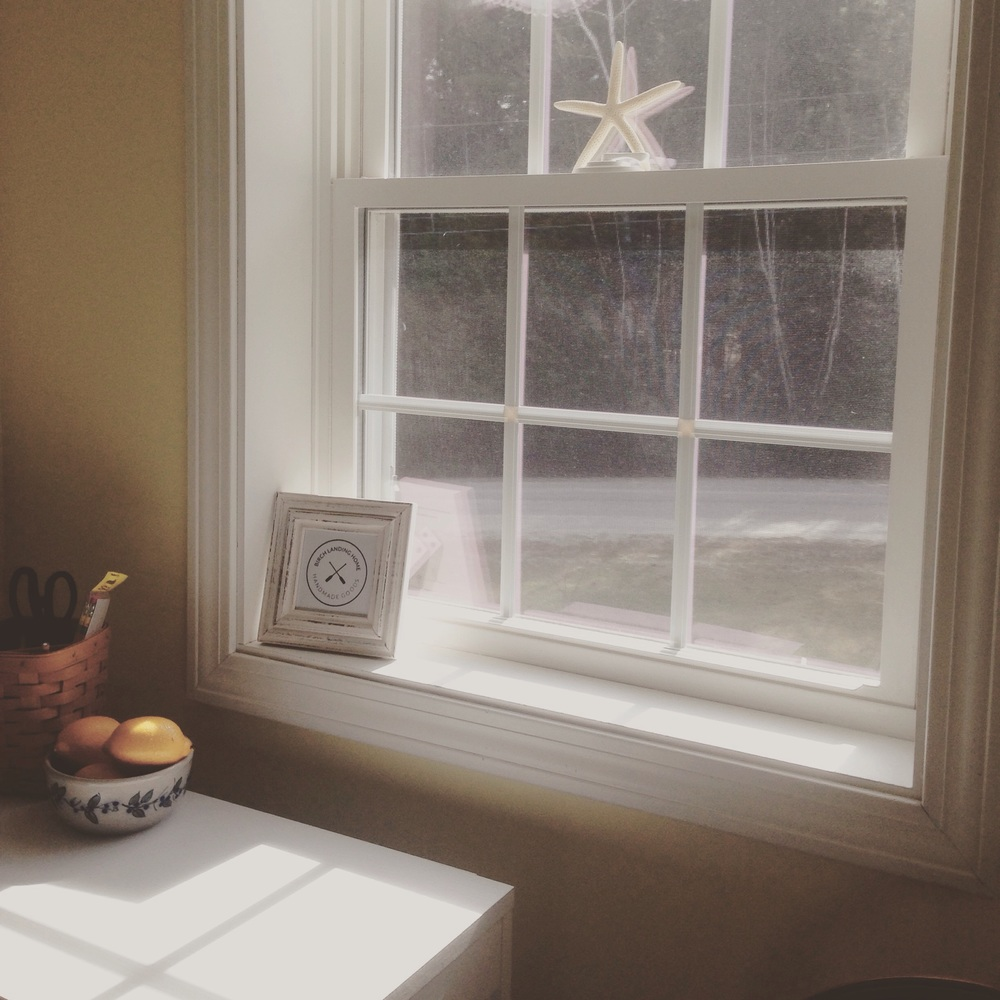 Sunshine through the window, craft supplies, bowl of lemons, starfish