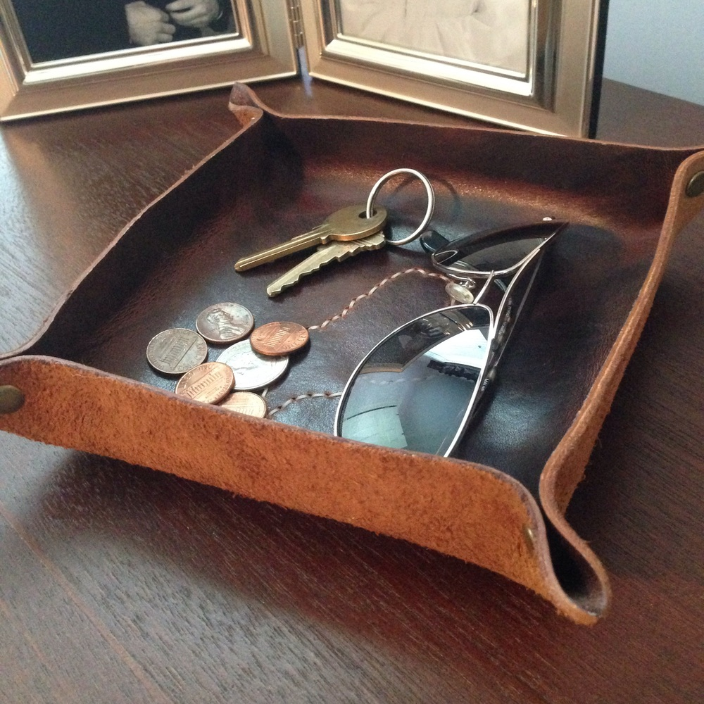 Leather catch-all is perfect for holding your keys, change, and sunglasses