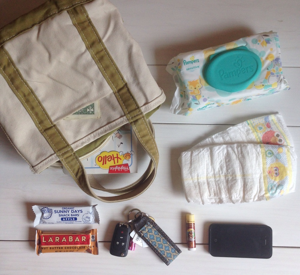 What's in my bag for toddler mamas:  Highlights Hello book, snacks, chapstick, Pampers diapers and wipes