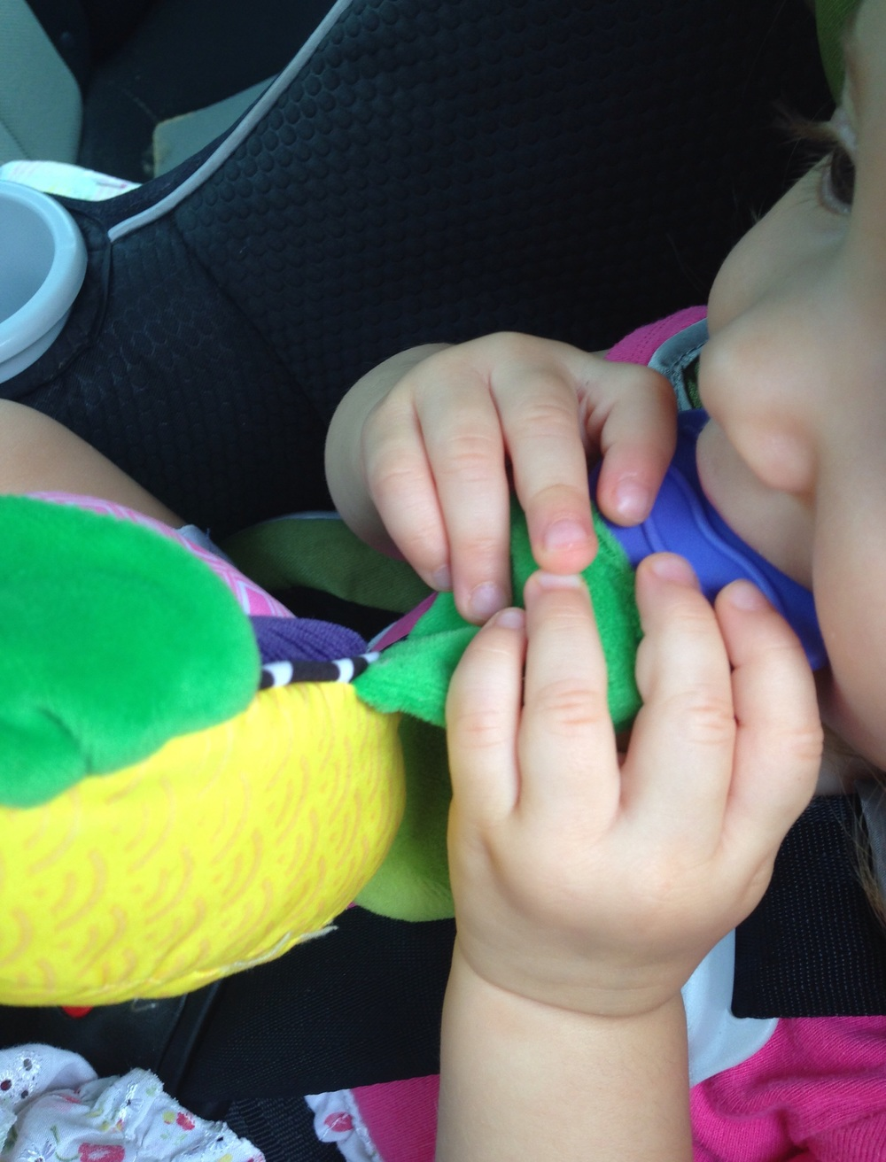 Teething tips.  Using a Nuby teether.
