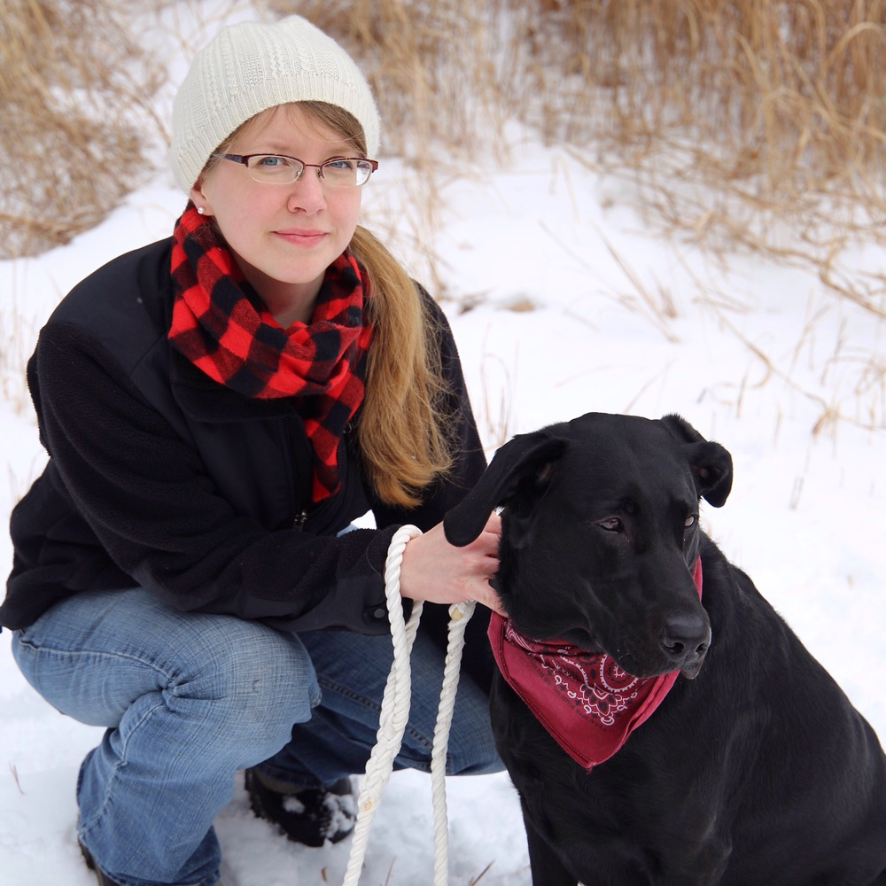 Sarah of Birch Landing Home and Harley the black lab