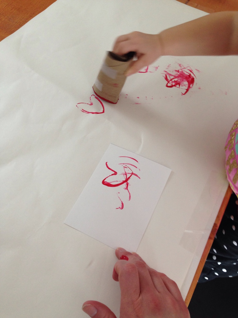 Toddler art; toddler stamping hearts for Valentine's Day
