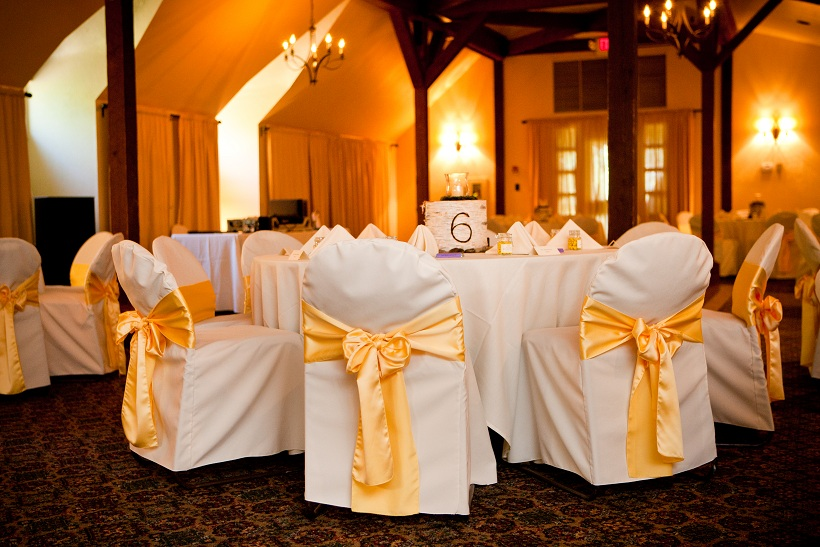 A rustic hall for the wedding reception doesn't require a lot of decoration.