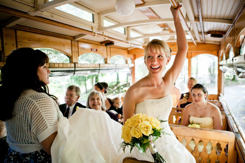 A great candid shot of riding the trolley to the wedding reception.