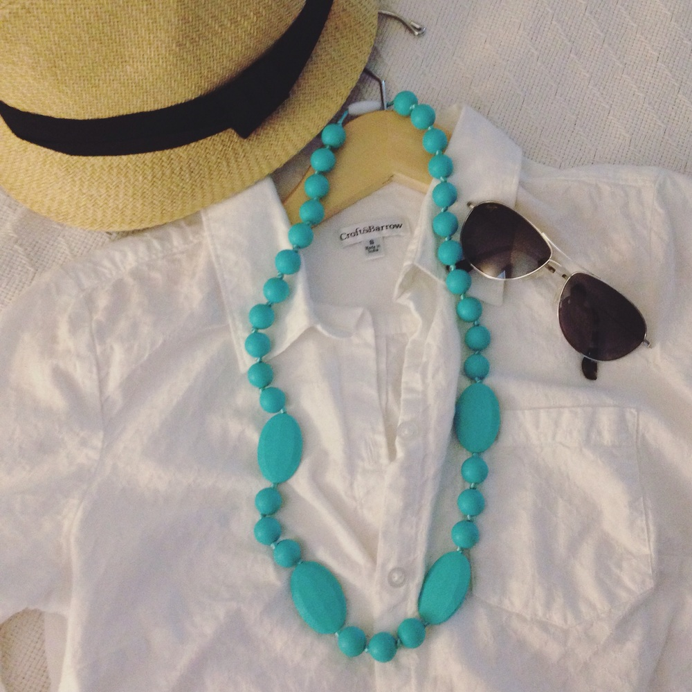 This is probably one of my favorite combos and a perfect outfit for a lunch out with friends.  This necklace really pops against the crisp white linen shirt and the straw fedora and aviator sunglasses add some more fun, trendy elements.