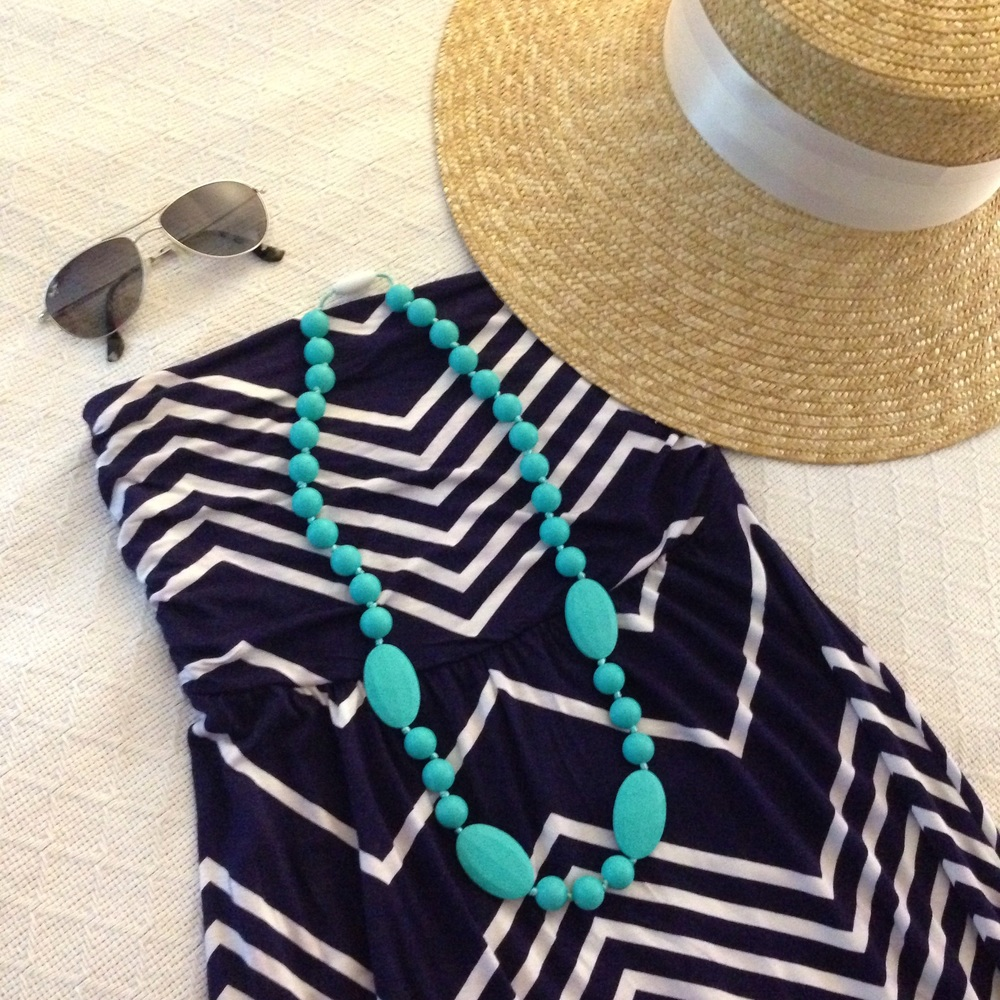 The teal teething necklace also pairs perfectly with this geometric print maxi dress, over-sized sunhat, and sunglasses.  Perfect outfit for getting ice cream with the family down at the water.