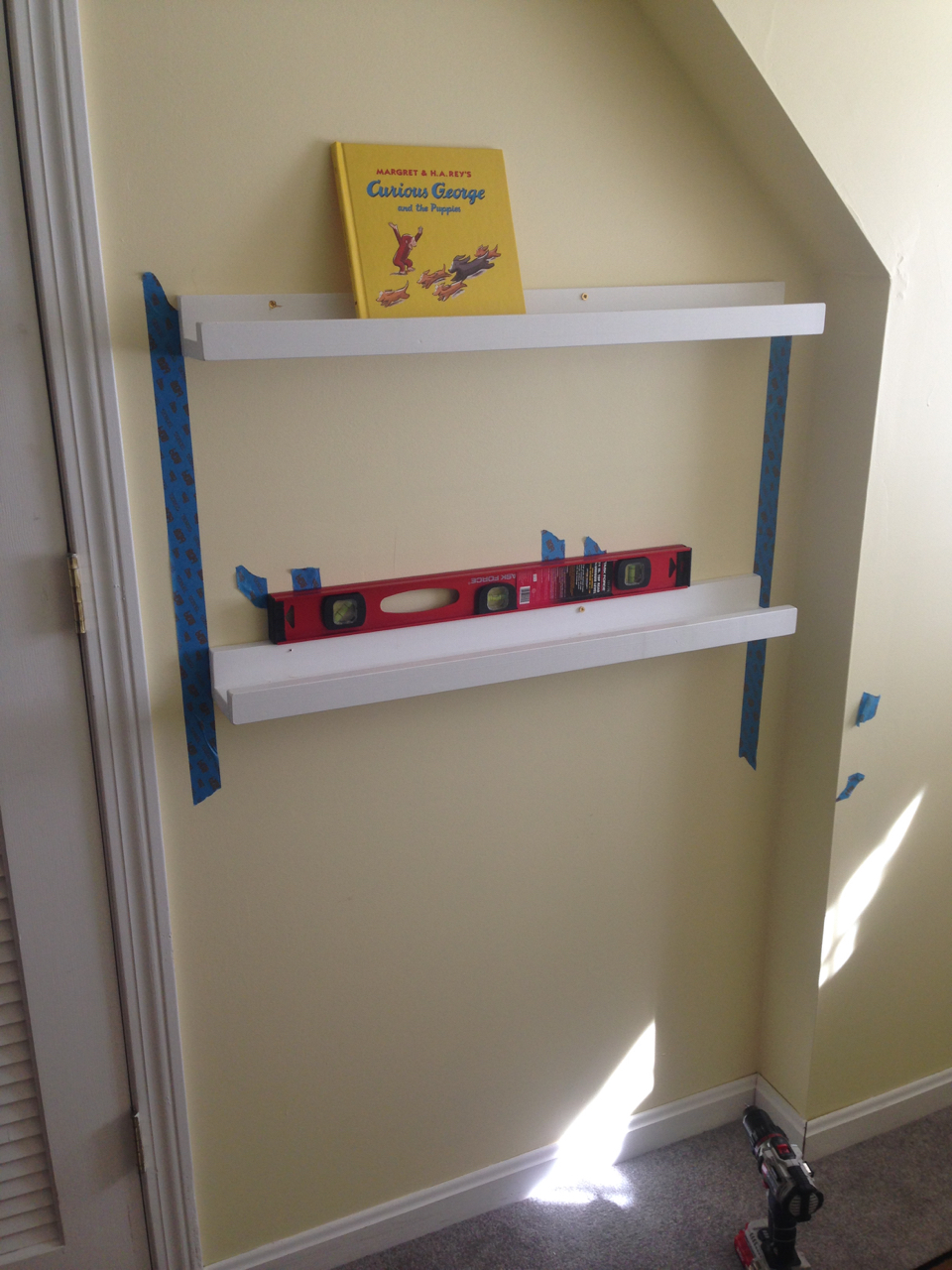 Leveling the book rails for hanging.