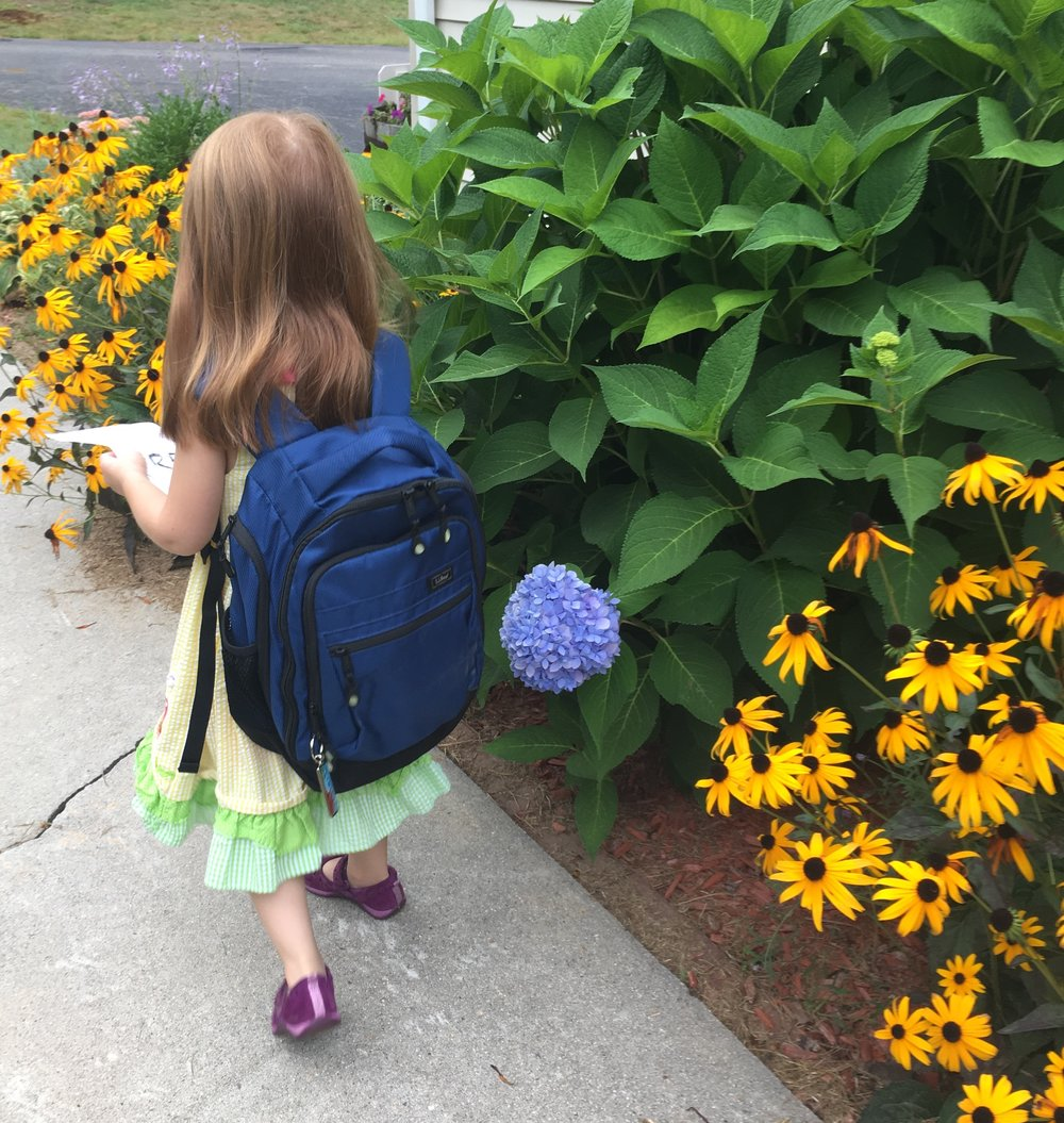 Quality backpack and clothes from a consignment shop stretch your back to school budget farther!
