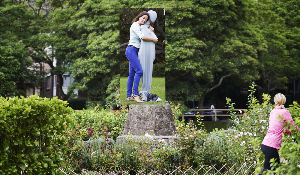 Talent was photographed at site, hugging a mannequin, posed to match the 3D model of the statue.