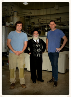Dr. Alastair Reed, Rabbi Mordechai Gutnick and Mark Sztar (winemaker)