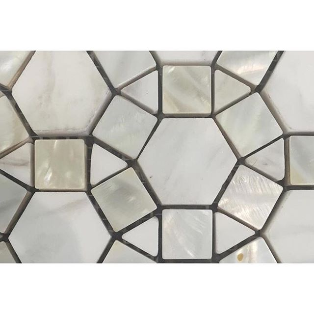 Designating tiles today for clients. We love this combination of mother of pearl and marble! Can't wait to use it!