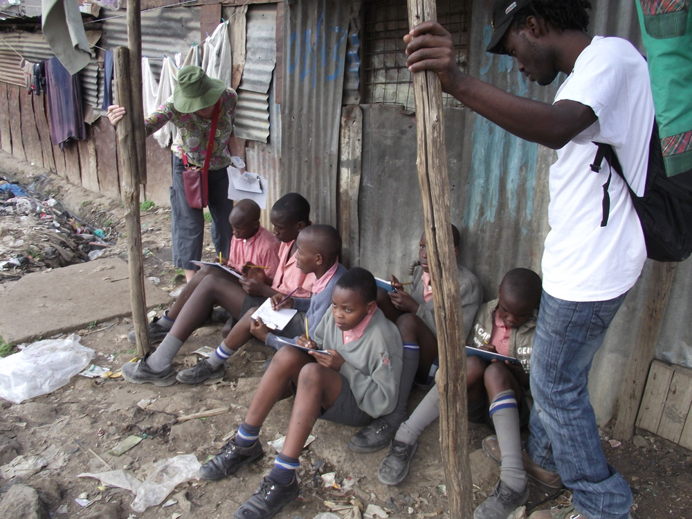 art Dickson and art class sketching in slums.JPG