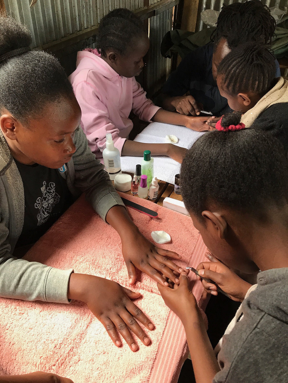 Kids learning manicure.jpg