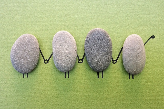 """""""Rock"""" by Wokandapix, CC0, https://pixabay.com/en/rock-art-craft-holding-hands-team-1573133/"""