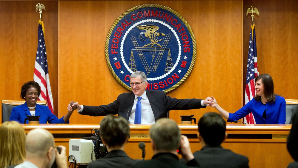 """FCC Chairman Tom Wheeler (center) joined the majority in a ruling that aims to ensure """"free, fast and open"""" Internet access. Credit: Wired"""
