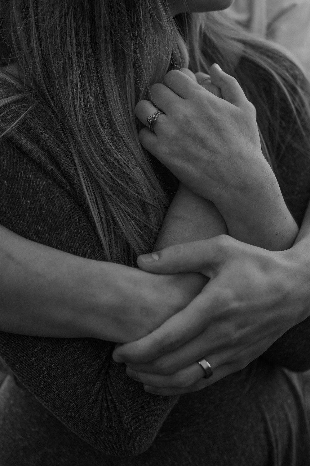 Arms wrapped around each other.