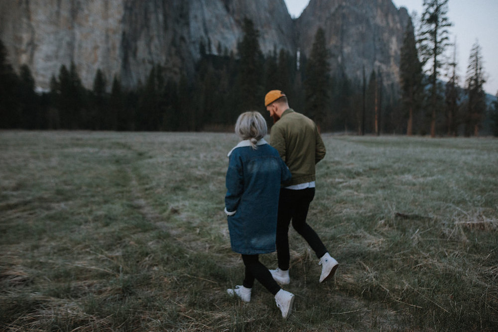 Couple walking together in Yosemite Valley.
