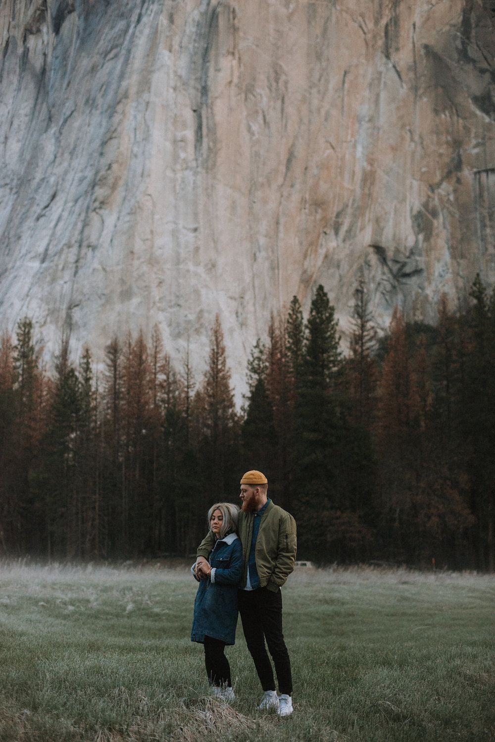 Couple relaxes in Yosemite Valley with El Capitan in the background.