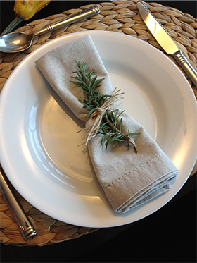 Use simple jute twine, wrap it around the napkin multiple times and tie a double knot to secure for a simple napkin ring. I placed a rosemary sprig to add a touch of color to my monochromatic table. Guests will also love the aroma.