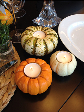 Mini pumpkins are everywhere! You might even have some left over from Halloween. Simply cut a hole large enough into the top of each pumpkin and insert a tea light candle. Scatter them down the center of your table and put one at each place setting. When the day is done, you can throw them away or compost them. The days of scraping wax off of your crystal candle sticks after dinner will be a thing of the past!