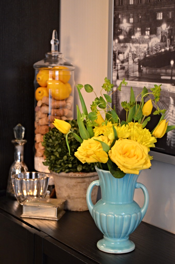 These beautiful yellow roses, tulips, and mums were left over from my coffee table arrangement. I decided to use my nan's vase for added color and contrast.
