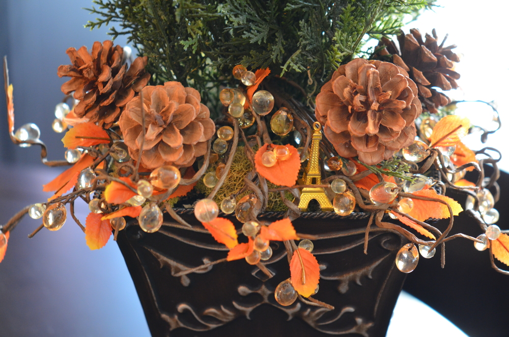 Use wreath picks to decorate the base of cache pots, candle sticks, or even as napkin rings.  The wire construction really allows you to mold them in any shape you need.
