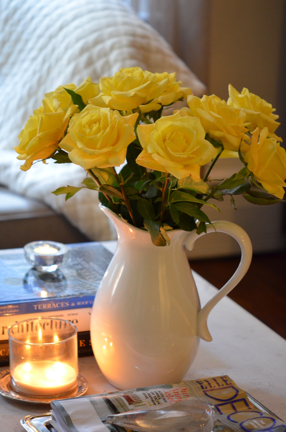 Deep yellow roses are a wonderful contrast to orange and soften the theme.  These can be changed out weekly and will add new life to your space.  Arrange them in a large pitcher for a more casual feel.  Change the color weekly; orange, red, white, or purple, or even hot pink!