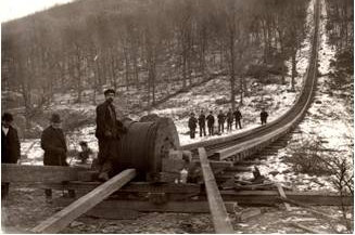 A work crew installs the railway's 1-3/8 inch lang-lay pattern steel cable, which weighed 7,000 lbs. The cable manufacturer was likely John A. Roebling's Sons, Inc. of Trenton, NJ    Courtesy Beacon Historical Society