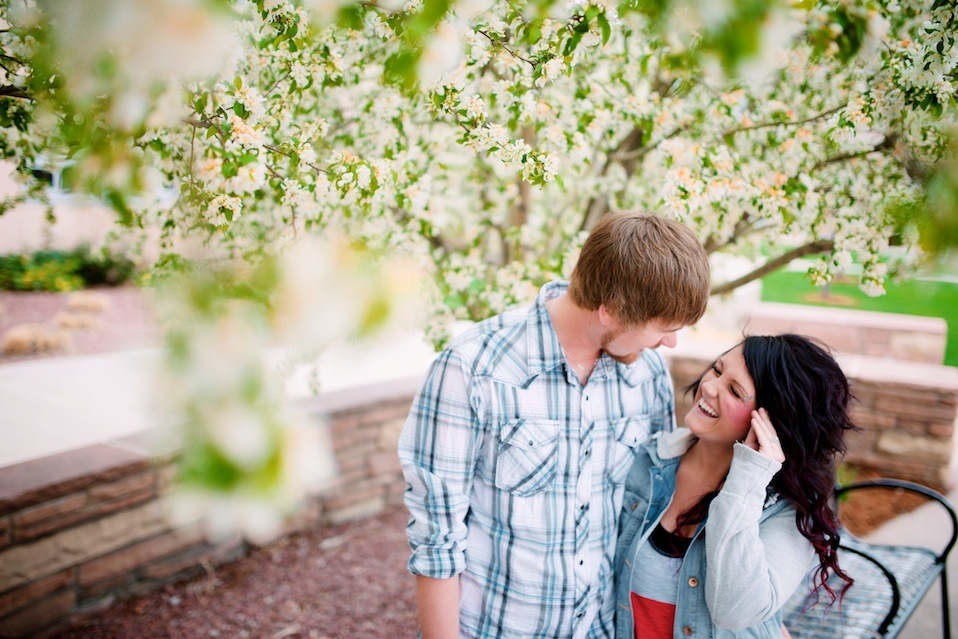 maddie-mae-maddiemaephoto-maddie-mae-photo-maddie-wilbur-madeleine-wilbur-maddie-mae-photography-pearl-street-engagement-shoot-boulder-engagement-photoshoot-multi-colored-brick-wall-pearl-street-engagement-shoot-spring-engagement-photo-tree-blossom-engagement-photos