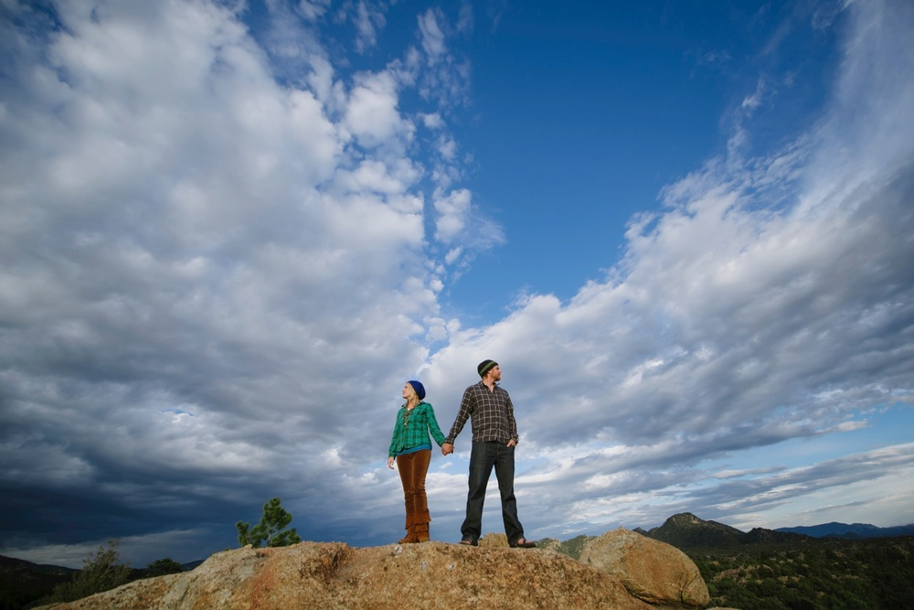 Super epic adventurous engagement photo pose by Maddie Mae Photography. Check out that amazing sky!