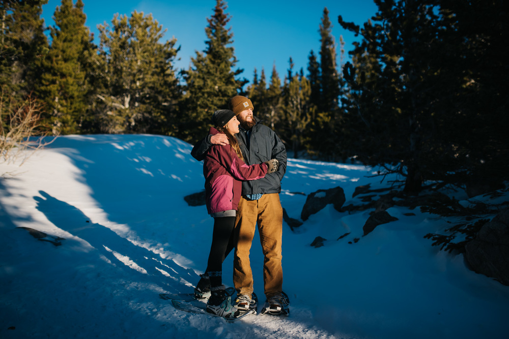 Gorgeous sunrise photo on a beautiful snowshoeing engagement shoot by Maddie Mae Photography